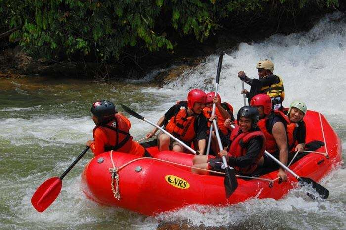 A group enjoying water rafting at Perak