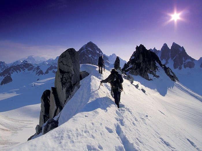 Mountaineers in Manali making their way through dense snow