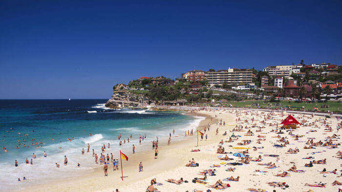 Tourists relax and enjoy at the Bondi beach