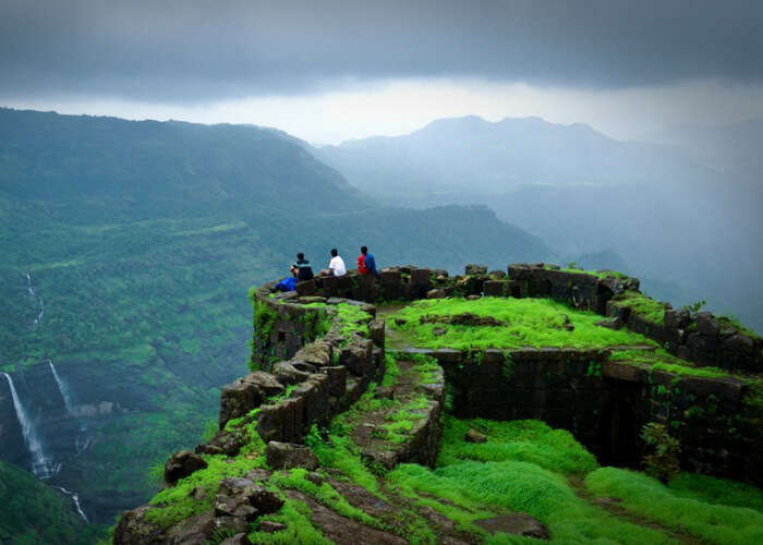 Tourists rest at the beautiful Rajmachi Fort