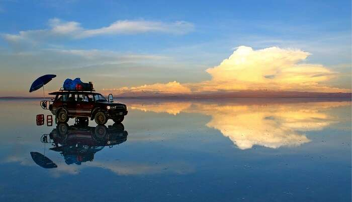 An SUV and its reflection at the Salar De Uyuni nature fields