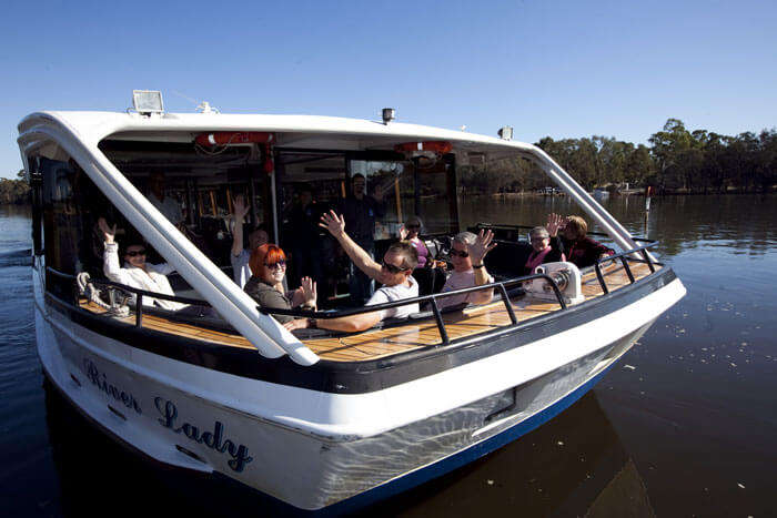 Tourists enjoy sightseeing in Perth in the Captain Cook Cruises