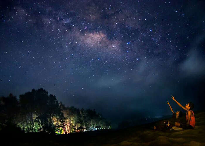 Two children enjoy the breathtaking experience of stargazing at Tarkarli