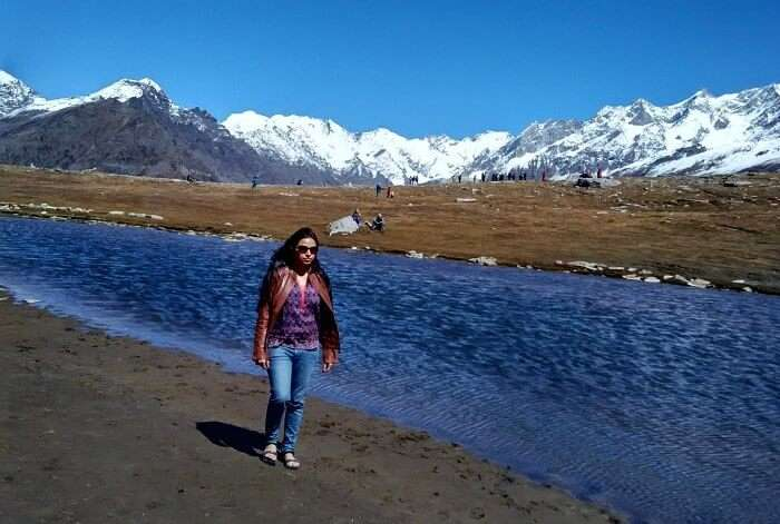 Rajeev's wife beside a stream in Rohtang Pass