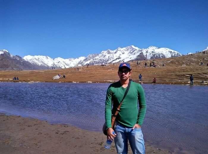 Rajeev posing beside a stream