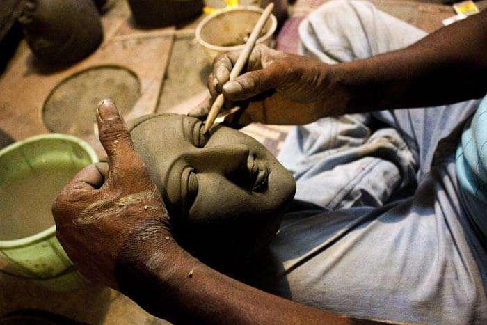 An artist making idol of Durga Maa for Durga Puja 2015