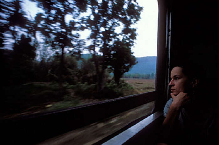 A female traveler looking out of a train window
