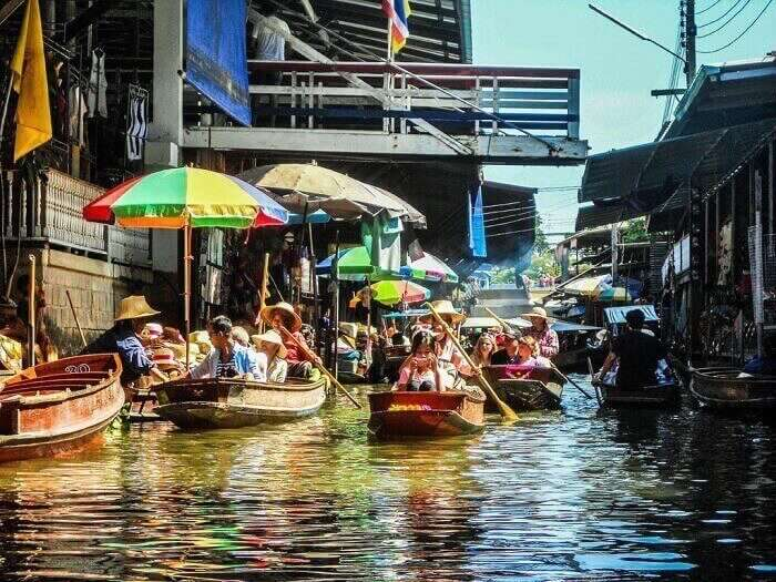 Floating market in the canals of Bangkok in Thailand