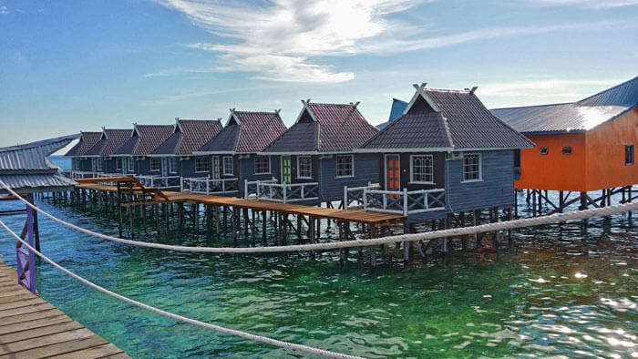 Wooden houses at BillaBong Scuba are built on spikes in the water