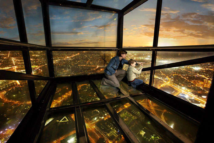 Mother and son looking out of Eureka Skydeck – One of the top fun things to do in Melbourne
