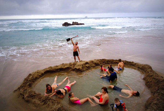 People enjoying at the Coromandel Peninsula's Hot Water beach