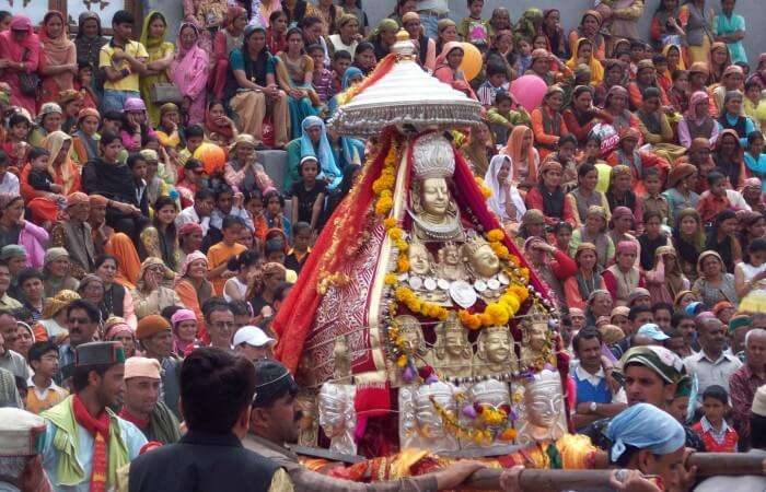 The procession carrying the idol of Raghunath temple in Kullu