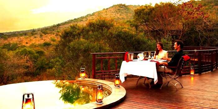 A couple enjoying wine and solitude at Kwazulu Natal