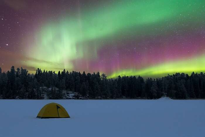 A camping tent on a frozen lake