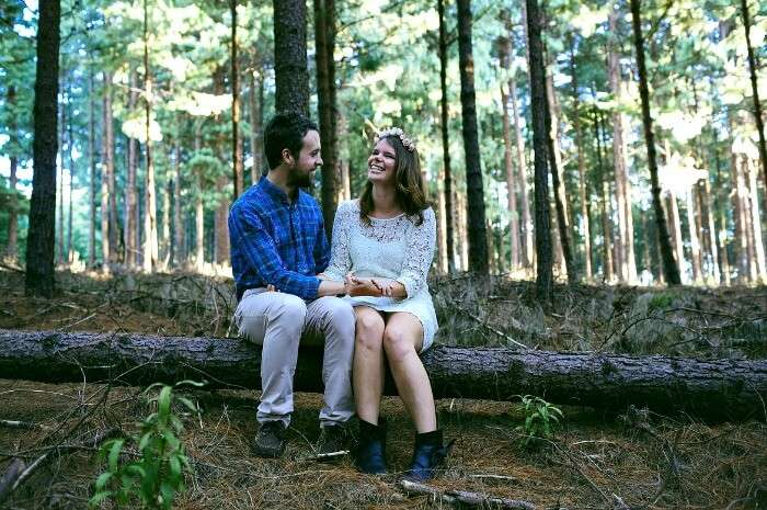 A couple sitting on woods