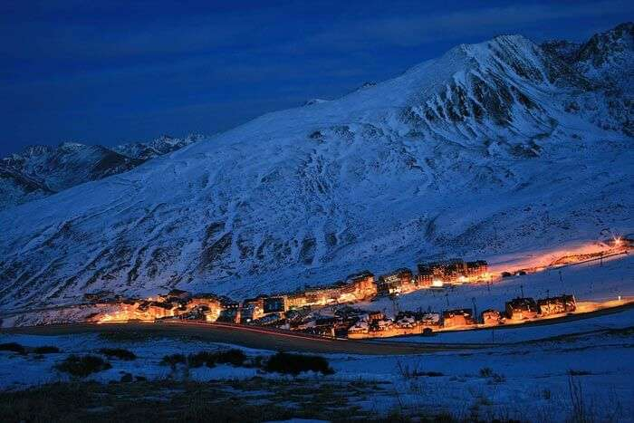 Night-time view of the town Encamp situated on the Valira d'Orient river in Andorra.