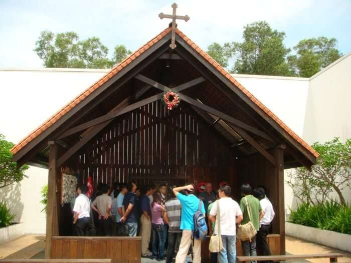 Tourists gather at the Changi Chapel inside the Changi museum