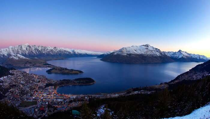 A wide camera shot of the night view of Queenstown in winter