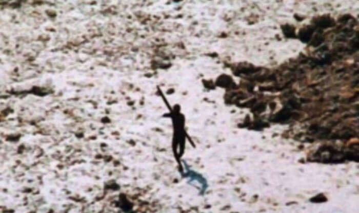 Sentinelese tribesman aiming arrow at the relief helicopter