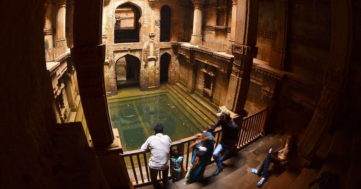 Visitors admire the architecture of Adalaj Ki Vav stepwell near Ahmedabad