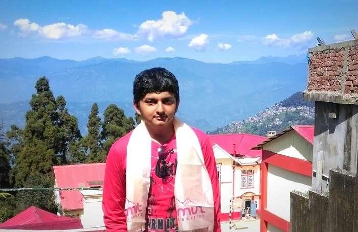 Balasubramanian posing in the backdrop of Darjeeling Hills
