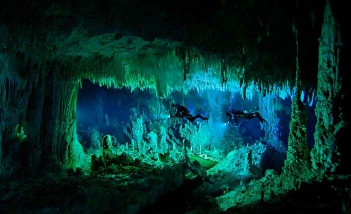 Two persons engaging in cave diving