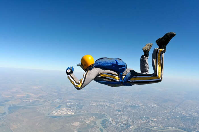 A person practicing free falling from an aircraft