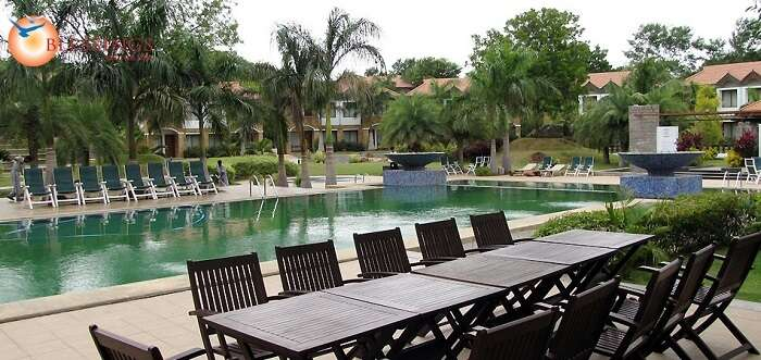 Pool at the  Golkonda Resorts and Spa amidst the greenery