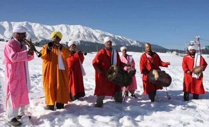 Artists performing popular folk tunes at Gulmarg Snow Festival
