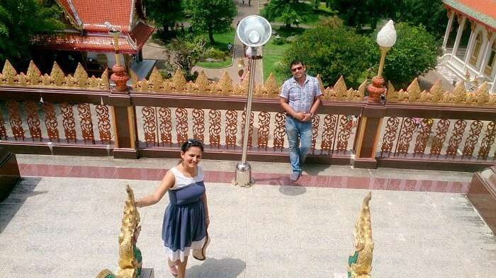 Apurva and her husband in a Buddhist temple in Bangkok
