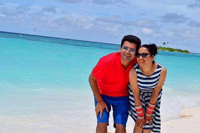 Yatin and his wife pose in front of the beach in Paradise Island and Resort Maldives