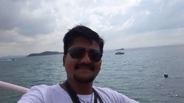 Amit clicking a selfie on the speed boat to Coral Island
