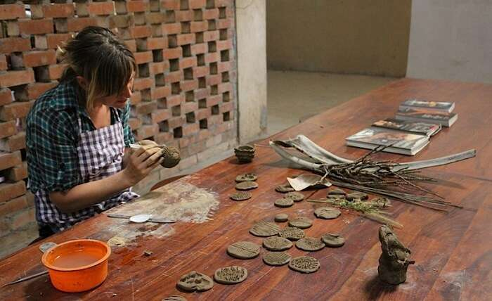 An enthusiast trying her hand at pottery at Urakam in Kerala