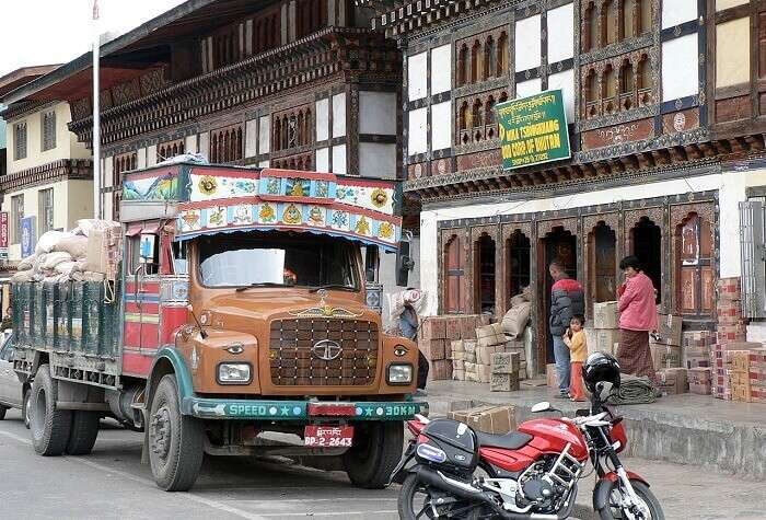 A view of shopkeepers unloading from the trucks on the Main Street at Paro