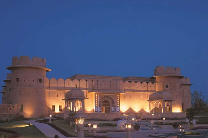 A shot of the beautifully lit Oberoi Rajvilas Resort in Jaipur