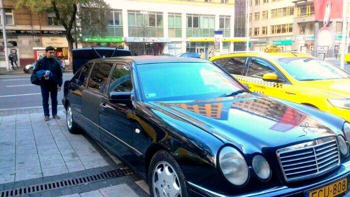 Enjoying the luxurious life in Prague by traveling in a Mercedes