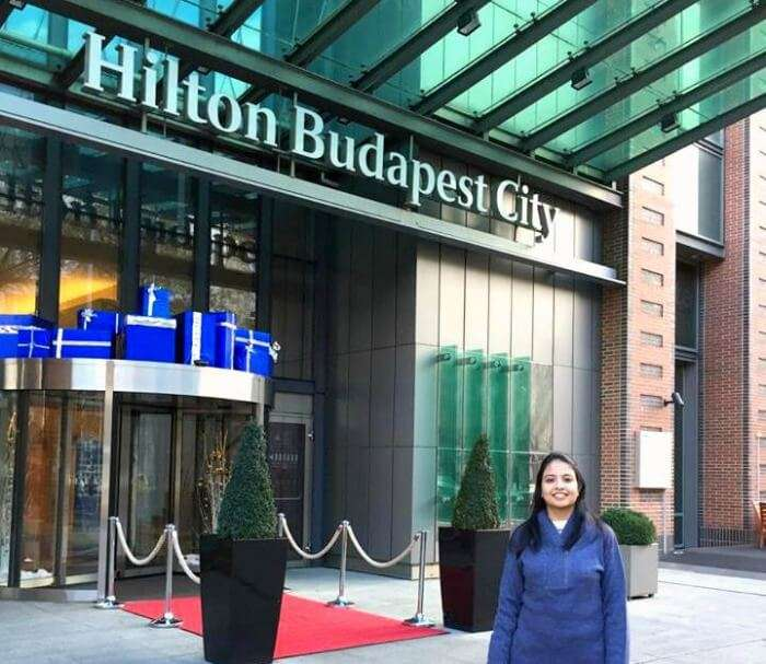Posing with the Hilton Hotel in Budapest