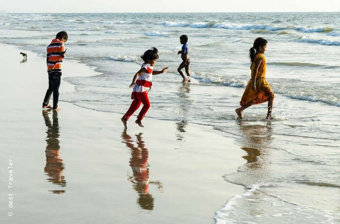 Kids enjoying themselves in the waves of the beaches in Goa