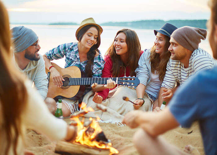 Have a laid back bonfire and barbecue party on New Year in Goa on a budget with your friends on a beach