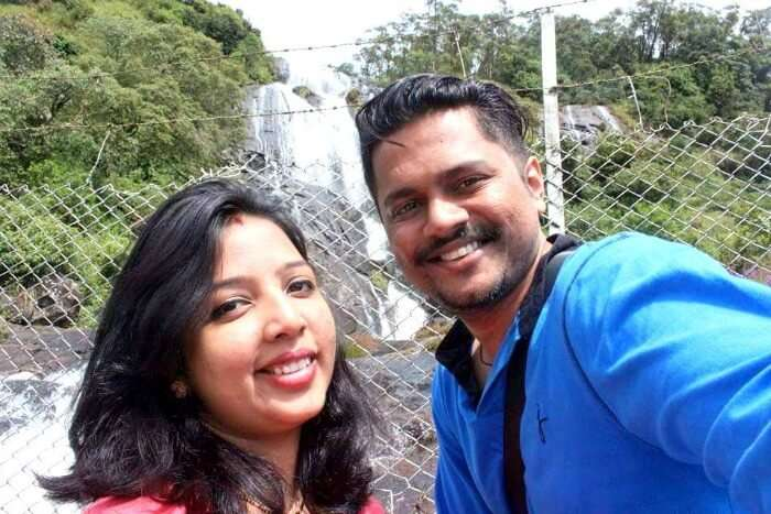 Yateen with his wife enjoying the beautiful view of the waterfall in Kerala
