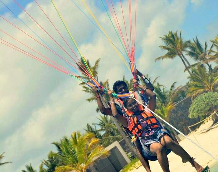 Karthik and his wife do parasailing in Mauritius