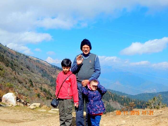 Pragatis children and father near Chelela Peaks in Bhutan
