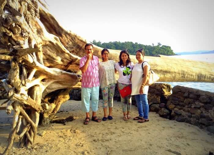 In front of a gigantic fallen tree