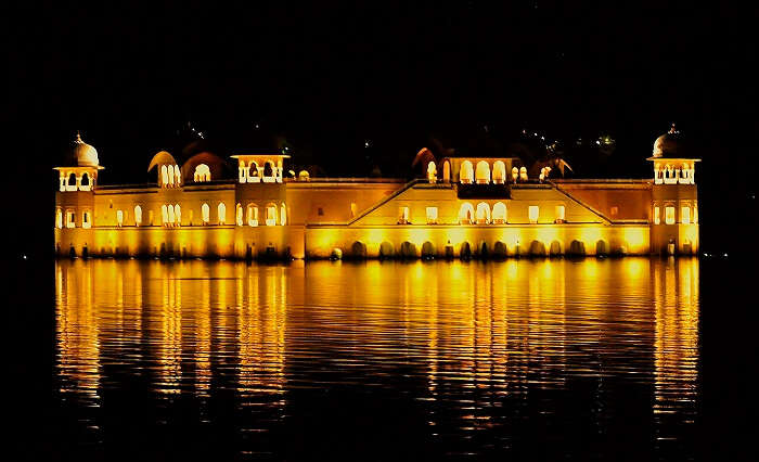 Golden hued Jal Mahal at night