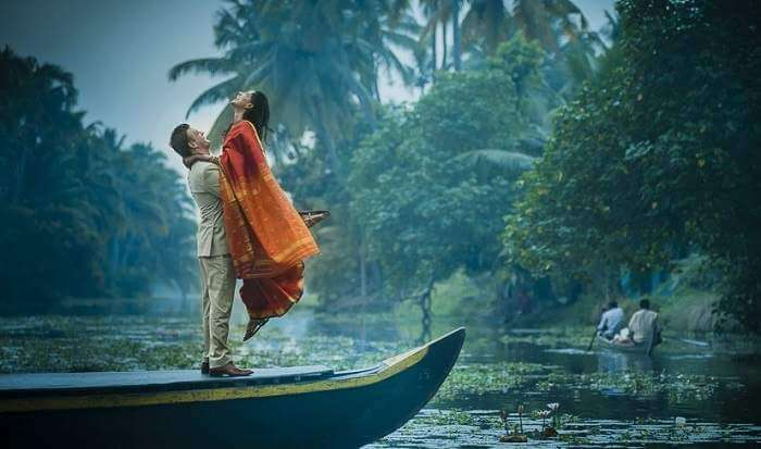 A couple enjoying at Kumarakom in Kerala which is one of the best honeymoon places in South India