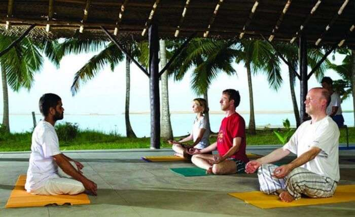 Guests meditating at one of the Yoga sessions at Poovar Island Resort