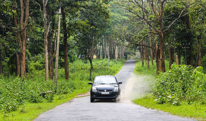 A car whizzing away on a road trip from Ahmedabad to Diu