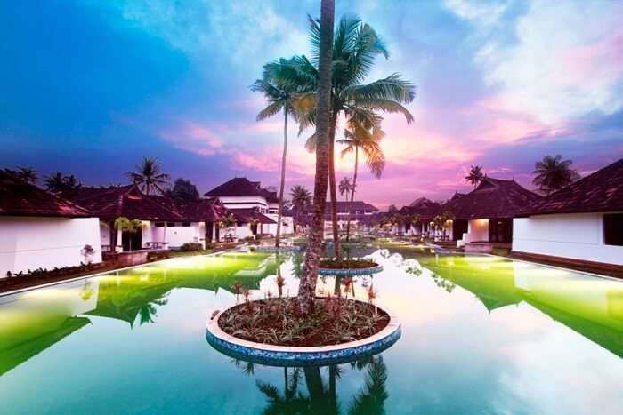 An evening shot of the grand pool at Aveda Resort in Kumarakom