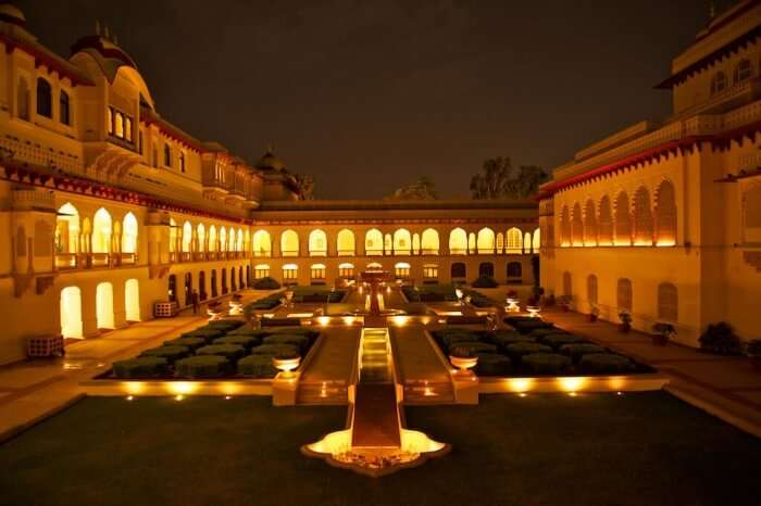 A view of the Rambagh Palace courtyard at night