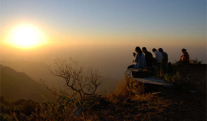 Friends enjoying sunset at the Sunset Point at Mount Abu in Rajasthan